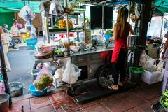 Street Vendor Prepare Noodle Soup From Their Food Cart On The St. Food cart like this dots the street of Bangkok, they are everywhere selling all sort of Stock Photo