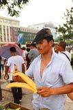 Street vendor prepares melon treat Stock Photography