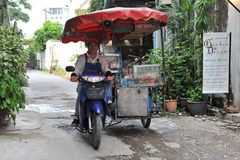 Street Vendor Rides a Mobile Kitchen Stock Photos