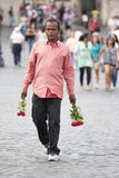 Street vendor of roses for tourists Stock Image