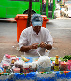 Street vendor selling betel leaves at Yangon Stock Images