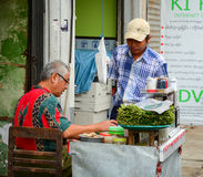 Street vendor selling betel leaves at Yangon Royalty Free Stock Images