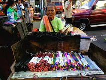 Street vendor selling candles Royalty Free Stock Image