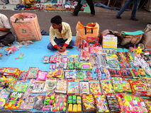 A street vendor selling colorful plastic toys Royalty Free Stock Photo