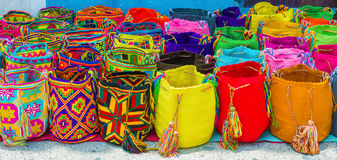 Street vendor selling craft bags in Cartagena, Colombia. Craft bags on display laying on the street in Cartagena, Colombia royalty free stock images