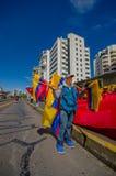 Street vendor selling ecuadorian flags for Royalty Free Stock Image