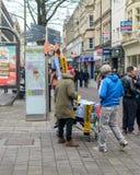 Street Vendor Selling Football Match Souvenier stock photo