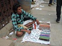 A street vendor selling ornamental items Stock Photo