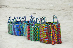 Street vendor selling straw hats and handbags. Ngapali beach in Myanmar Stock Photo