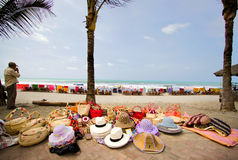 Street vendor selling straw hats and handbags Royalty Free Stock Photography