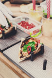 Street vendor selling taco outdoors, closeup of wrapped snacks Royalty Free Stock Image