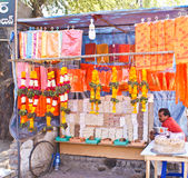 Street vendor selling temple items. Useful for pilgrims for performing religious rites and rituals in Lord Sai Baba Temple in Shirdi,Maharashtra,India Stock Photo