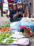 The street vendor selsl his fruits in Thamel in Kathmandu, Nepal Stock Photo