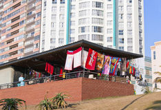 Street Vendor Stall Against Highrise Apartment Buildings Royalty Free Stock Images