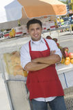 Street Vendor Standing by fruit Salad Stall stock image
