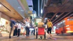 Street Vendor Thai Woman Sell Fresh Citrus Juice Near Phrom Phong BTS Subway Train Station. Bangkok Night Traffic Time. Lapse. 4K. Bangkok, Thailand - 01 DEC stock footage