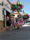 Street vendor of toys and balloons Royalty Free Stock Photos