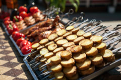 Street vendor tray with vegetable and meat kebab Stock Photo