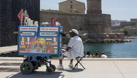 Street vendor with trolley. Street vendor selling drinks and coffee at the waterfront in Marseille, France Stock Image