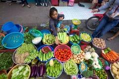 Street Vendor Vietnam. Ho Chi Minh City, Vietnam: Street vendor selling a variety of fresh vegetables on the sidewalk Stock Photos