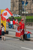 Street Vendor Walking on Canada Day Royalty Free Stock Image