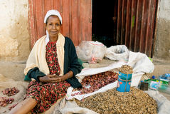 Street vendor woman in harar ethiopia. With coffee husks and shallots Royalty Free Stock Image