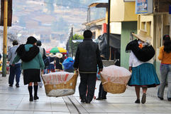 Street vendors carrying baskets of bread Royalty Free Stock Images