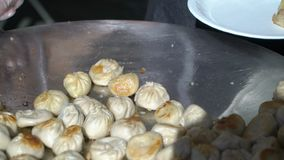 Street vendors cook Nepalese traditional dumpling momos.