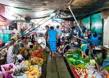 Street vendors on famous Maeklong Railway Market. Maeklong, Thailand - May 24, 2014: Street vendors on famous Maeklong Railway Market.Whenever a train approaches Stock Photography