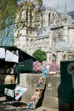 Street vendors in front of the notre dame cathedral in Paris, France stock images