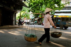 Street vendors Hanoi. Busy street vendors Hanoi Vietnam Stock Image