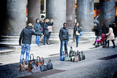 Street vendors in Rome. Selling bags. Photo taken in January 2014 in Rome, Italy near Pantheon Royalty Free Stock Photo