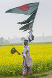 A Street vendors sell Bangladeshi national flags in a winter day, Munshigonj, Dhaka, Bangladesh, Asia. Ahead of the country's 44th Victory Day celebrations Stock Photography