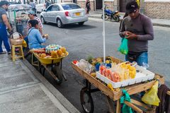 Street vendors sell fruits in colonial city Popayan. POPAYAN, COLOMBIA - SEPTEMBER 10, 2015: Street vendors sell fruits in colonial city Popayan, Colombia stock photography