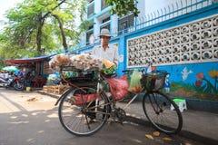 Street Vendors selling foods girdle mix cake . Street vendors are very common in the street Stock Image