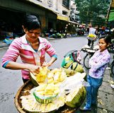 Jack Fruit Sellers. Street vendors selling Jack Fruit on the streets of Hanoi's Old Quarter Stock Images