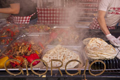 Street vendors selling vegetables and meat stuffed roasted pie Stock Images
