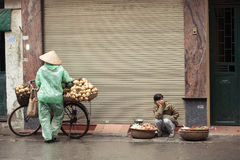 Street vendors on the streets of Hanoi, Vietnam. Royalty Free Stock Photography