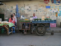 Street vendors wait for customers Royalty Free Stock Images