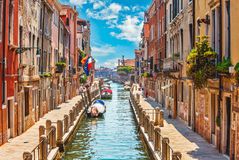 Street in Venice with canal boat Stock Images