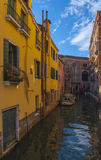 Street in Venice, Italy. Blue sky and Canal with boats in Venice, Italy Stock Photography