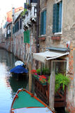 Street in Venice, Italy. One of the small streets-canals in Venice Stock Photos