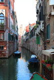 Street in Venice, Italy. One of the small streets-canals in Venice Stock Photography