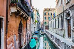 Street in Venice - water canal, boats and residential houses Royalty Free Stock Photos