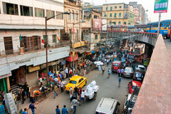 Street view from above with private cars, taxi cabs and working people. KOLKATA, INDIA: Street view from above with private cars, taxi cabs and working people of Stock Photo