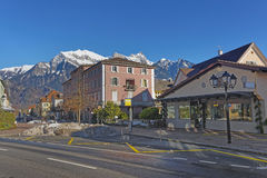 Street view and the Alps in the Town of Bad Ragaz Royalty Free Stock Photos