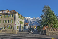 Street view and Alps in the Town of Bad Ragaz Stock Photography