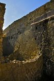 Wall Structures, Herculaneum. Street View in Ancient Herculaneum. Portrait Mode. Herculaneum was buried in the eruption of Mount Vesuvius in AD 79. Unlike Royalty Free Stock Photos