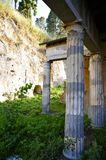 Ancient Columns, Herculaneum. Street View in Ancient Herculaneum. Portrait Mode. Herculaneum was buried in the eruption of Mount Vesuvius in AD 79. Unlike Stock Photography