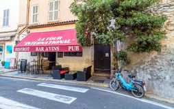 Street view in Antibes old town, France. Antibes, France - June 29, 2016: day view of typical street with bistrot in Antibes, France. Antibes is a popular Stock Photography